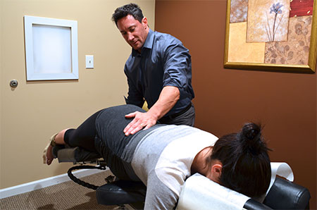 Alpharetta Chiropractor Dr Lubow performing adjustment
